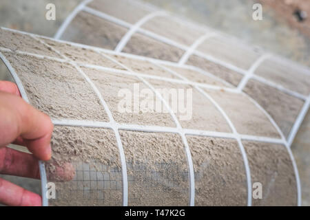 Close up dirty dust on air conditioner filter ,Cleaning or changing the filter in the air conditioning for safe healthy housing air conditioning - Stock Photo
