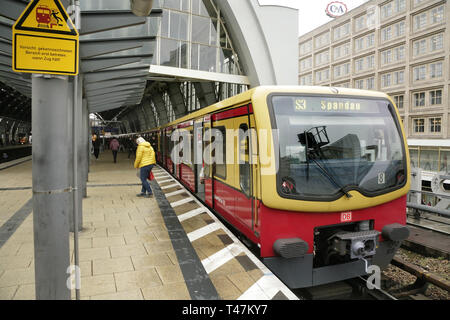 S-bahn train bound for Spandau at the Alexanderplatz station, East Berlin, Germany. - Stock Photo