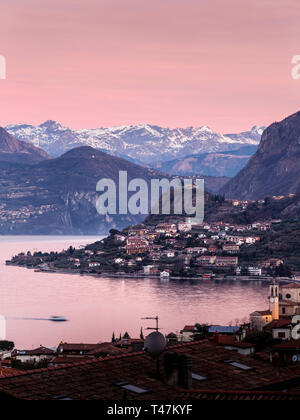 Lake Iseo at dawn, seen from Sale Marasino to the north and the Alps, Lombardy, Italy - Stock Photo