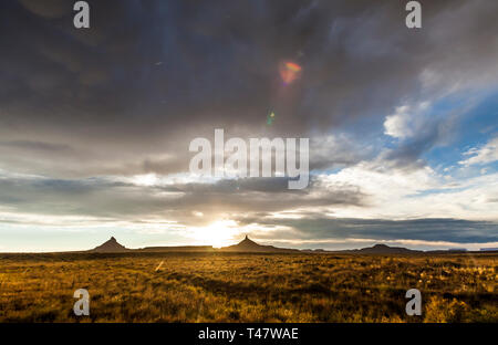 Rain falling from the sky after a storm passes and the sun sets over Canyonlands National Park in Southeast Utah, USA. North and South Six-Shooter Pea - Stock Photo