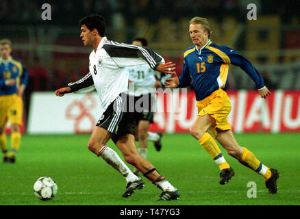 Westfalenstadion Dortmund Germany 14.11.2001, Football qualifier for the FIFA World Cup 2002, Germany (white) vs Ukraine (blue) --- Michael BALLACK (GER), Andrej GUSIN (UKR) - Stock Photo
