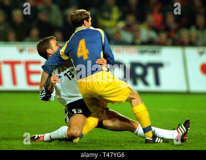 Westfalenstadion Dortmund Germany 14.11.2001, Football qualifier for the FIFA World Cup 2002, Germany (white) vs Ukraine (blue) --- Oliver BIERHOFF (GER), Alexander GOLOWKO (UKR) - Stock Photo