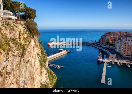 High Cliff of Monaco Ville and Port de Fontvieille on Mediterranean Sea - Stock Photo
