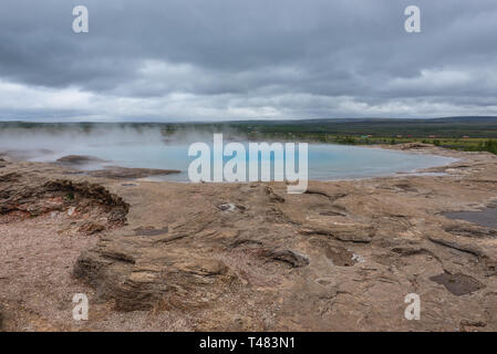 The Great Geysir in geothermal area beside the Hvita River in Haukadalur valley, Iceland - Stock Photo