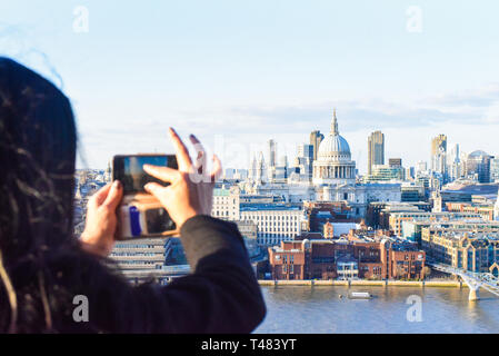 aerial skyline view of the city, North Bank with St Paul's and Millennium Bridge, London, UK, mobile photo - Stock Photo