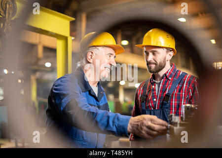 Showing how to use machine - Stock Photo