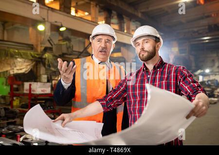Foreman and subordinate - Stock Photo