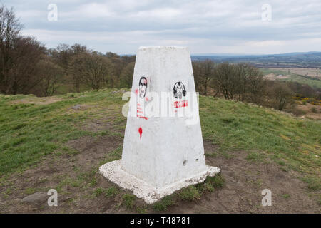 white trigpoint with stencil graffiti - Castle Hill Hillfort, nr Bar Hill Fort, Antonine Wall,  Twechar, East Dunbartonshire, Scotland, UK - Stock Photo