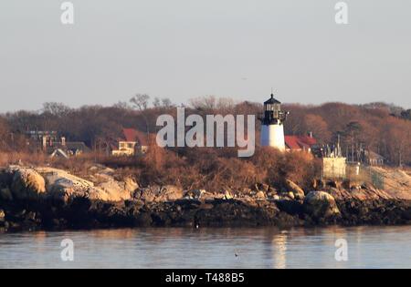 Ten Pound Island Lighthouse on Ten Pound Island, Gloucester, Massachusetts, at sunset - Stock Photo