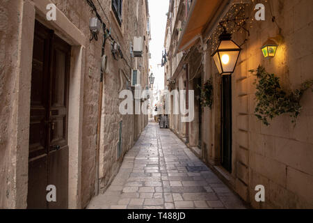 Dubrovnik, Croatia - april 2019: Old City of Dubrovnik. One of many narrow streets of medieval town - Stock Photo