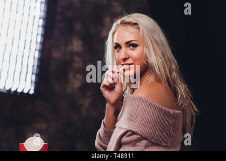 Attractive Twenty Something Young Woman Eating Chips. - Stock Photo