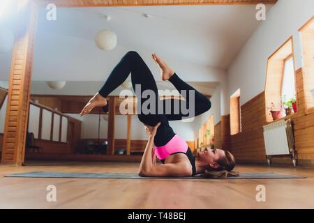 yoga pose woman doing setu bandha sarvangasana bridge