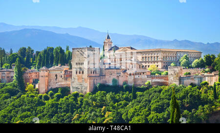 Beautiful Alhambra Palace complex in Spanish Granada on a sunny day captured on 16:9 photography. The amazing fortress and popular tourist spot. - Stock Photo