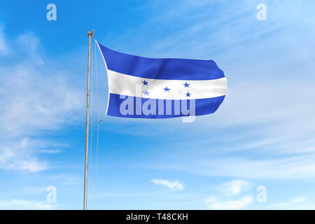Honduras flag blowing in the wind over nice blue sky background - Stock Photo