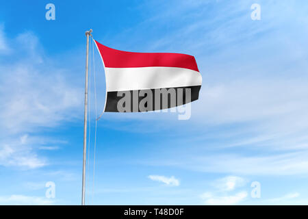 Yemen flag blowing in the wind over nice blue sky background - Stock Photo