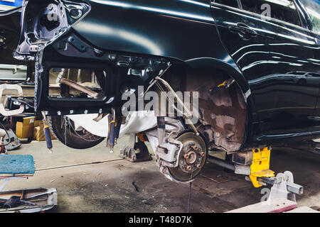 Tuning the car in a sedan body with three layers of noise insulation of the trunk. Audio and vibration isolation. Soft material. Dismantled car - Stock Photo