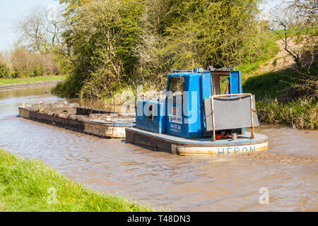 Maintenance repair work and dredging of the Macclesfield canal  being carried out at Buglawton Cheshire England UK - Stock Photo