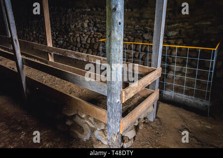 Interior of old turf sheephouse of Hjardarhagi farm in eastern Iceland - Stock Photo
