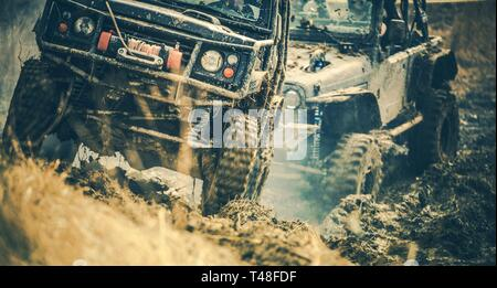 Off Road Trail Expedition. Two Sport Utility Vehicles Covered in Mud on the Rural Road. - Stock Photo