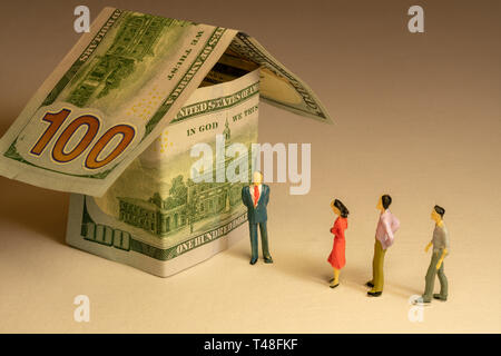 People wait in queue at front of the house made from hundred dollar bills. Real estate expenses building mortgage and property concept. - Stock Photo
