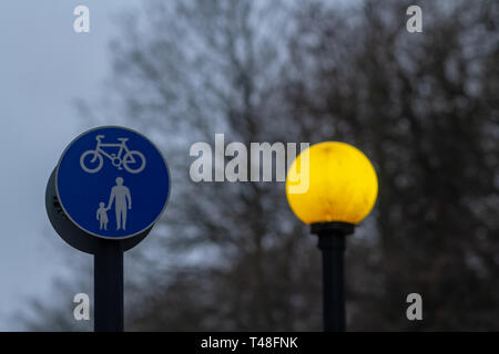 Yellow street lamp and road sign - Separate lanes for pedestrians and cyclists - Stock Photo