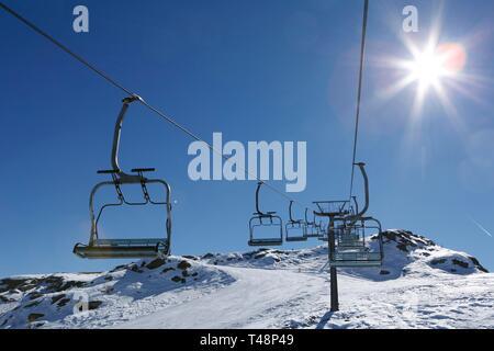 Chair lift, ski slope Tognola, ski area, San Martino di Castrozza, Trentino, Italy - Stock Photo