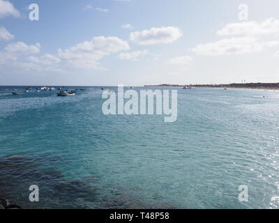 Turquoise waters of Atlantic Ocean landscape at african town of Santa Maria on Sal island in Cape Verde - Stock Photo