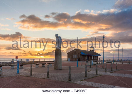 The mythical bird sculpture, part of the Tern Project, on the Stone Jetty at Morecambe, Lancashire, England, UK as the sun sets over Morecambe Bay - Stock Photo