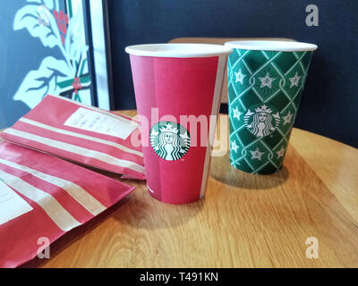 MONTREAL, CANADA - NOVEMBER 18, 2018: Starbucks coffee and latte with caramel on a table. Starbucks is an American coffee company and coffeehouse chai - Stock Photo