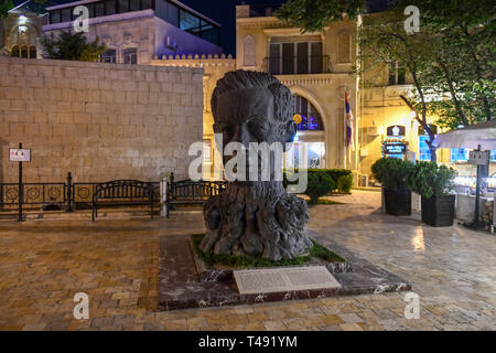 Baku, Azerbaijan - July 14, 2018: Sculpture head of Aliaga Vahid in Old City of Baku. Vahid was Azerbaijani poet, known for reintroducing medieval gha - Stock Photo