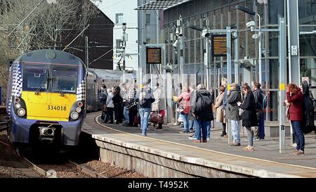 Train with commuters or passengers at Partick railway station, Glasgow, Scotland, UK - Stock Photo