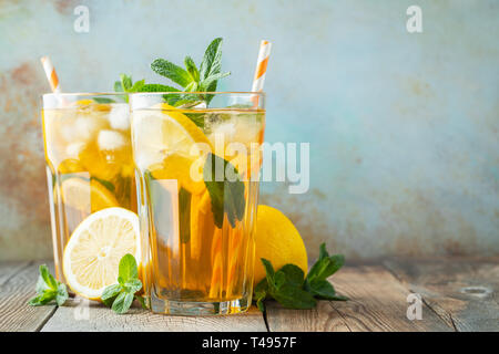 Iced tea with lemon and ice in tall glasses. - Stock Photo