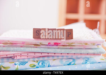 Scrapbooking alphabet wooden stamp and colorful cloth - Stock Photo