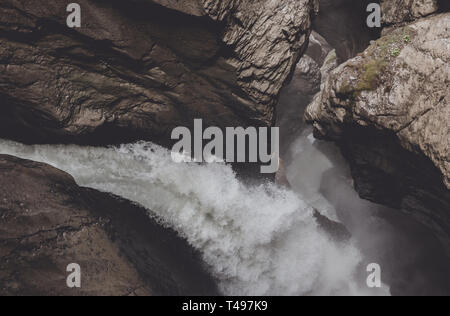 View closeup waterfall of Trmmelbach fall in mountains, valley of waterfalls in national park of city Lauterbrunnen, Switzerland - Stock Photo