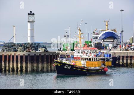 Fishing boat entering harbour, Kirkwall, Mainland, Orkney Islands, Northern Isles, Scotland, United Kingdom - Stock Photo
