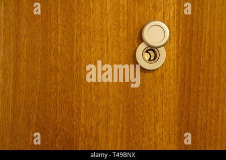 Door lens in the wooden background - Stock Photo