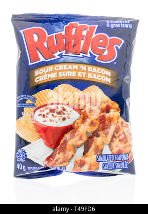 Winneconne, WI -  13 April 2019: A bag of Ruffles sour cream and bacon potato chips on an isolated background - Stock Photo