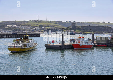Mount Batten and Cawsand Passenger ferries at landing stage Plymouth Barbican - Stock Photo