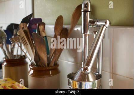 collection of wooden kitchen utensils in a modern kitchen - Stock Photo