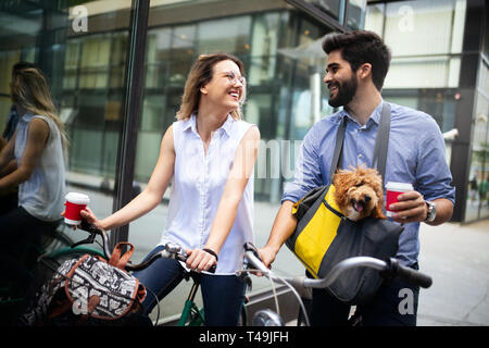 Happy young couple spending time together with dog and bicycles - Stock Photo