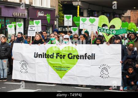 London, UK. 14th April 2019. Members of the Grenfell community and firefighters take part in the Grenfell Silent Walk around North Kensington on the monthly anniversary of the fire on 14th June 2017. 72 people died in the Grenfell Tower fire and over 70 were injured. Credit: Mark Kerrison/Alamy Live News - Stock Photo