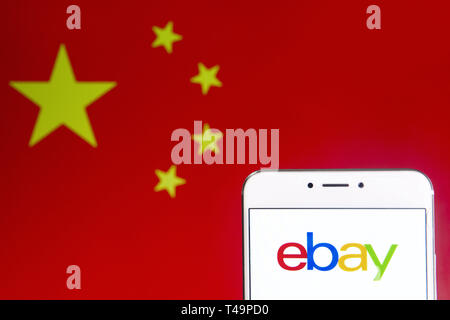 Hong Kong. 6th Apr, 2019. In this photo illustration a American multinational e-commerce online auction and shopping company Ebay logo is seen on an Android mobile device with People's Republic of China flag in the background. Credit: Budrul Chukrut/SOPA Images/ZUMA Wire/Alamy Live News - Stock Photo