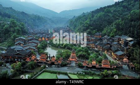 Beijing, China. 14th Apr, 2019. Aerial photo taken on April 14, 2019 shows the Dong village of Zhaoxing in Liping County, southwest China's Guizhou Province. Credit: Ou Dongqu/Xinhua/Alamy Live News - Stock Photo