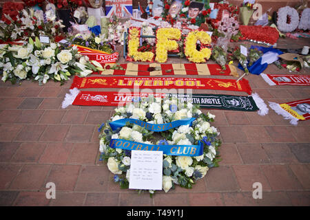 Liverpool. 15th Apr, 2019. A wreath of flowers left by the directors, players, staff and supporters of Chelsea FC at the memorial to the 96 victims of the Hillsborough Stadium Disaster, is pictured before the English Premier League match between Liverpool FC and Chelsea FC at Anfield in Liverpool, Britain on April 14, 2019. April 15 marks the 30th anniversary of the disaster. Credit: Xinhua/Alamy Live News - Stock Photo