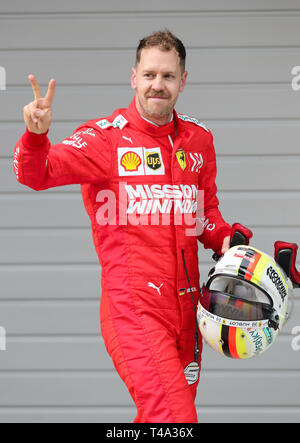 Shanghai, China. 14th Apr, 2019. Ferrari driver Sebastian Vettel of Germany gestures after the Formula One Chinese Grand Prix in Shanghai, China, on April 14, 2019. Credit: Ding Ting/Xinhua/Alamy Live News - Stock Photo