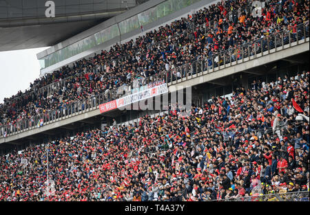 Shanghai, China. 14th Apr, 2019. Fans watch the Formula One Chinese Grand Prix in stands in Shanghai, China, on April 14, 2019. Credit: Ding Ting/Xinhua/Alamy Live News - Stock Photo