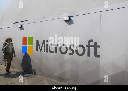 London, UK. 15th Apr, 2019. Pedestrians walk past a wall with the logo Microsoft Software giant as a new store prepares to open Oxford Street Credit: amer ghazzal/Alamy Live News - Stock Photo
