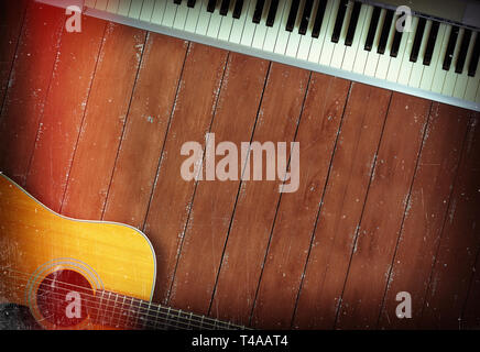 Musical instrument - Sloseup MIDI piano 61 key keyboard and acoustic guitar on a wooden background - Stock Photo