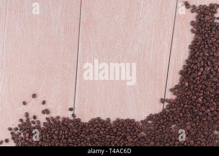 frame of roasted coffee beans on wooden background .photo with - Stock Photo