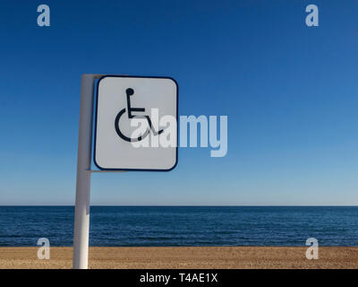 Disabled symbol showing internationally recognised sign for access and disabled facilities to beach and sea Marbella Costa Del Sol Andalusia Spain EU - Stock Photo